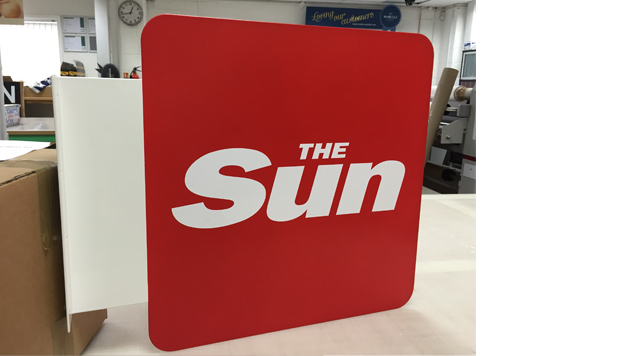 The Sun projecting signage